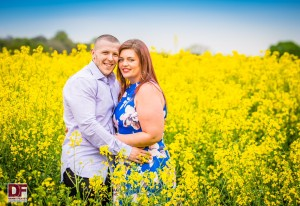 man and woman hugging in a field of rapeseed