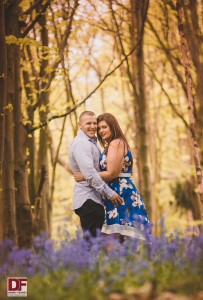man and woman hugging in a field of bluebells