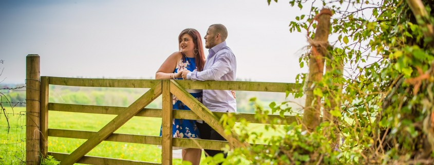 man and woman looking over a country gate